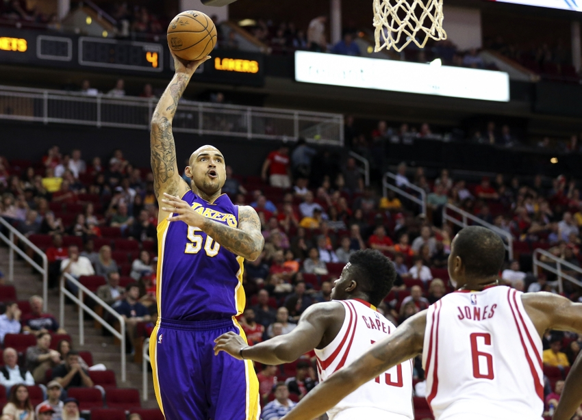 58211de8d71 Dec 12, 2015; Houston, TX, USA; Los Angeles Lakers center Robert Sacre (50)  shoots the ball during the fourth quarter against the Houston Rockets at  Toyota ...